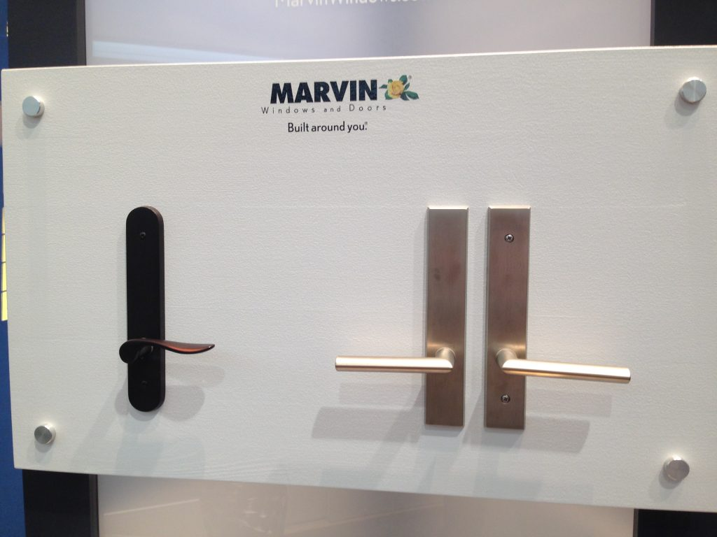 Marvin's Standard Hardware for Hinged Doors. Left Photos shows the traditional hardware. Right Side shows the Contemporary Hinged Door Hardware.